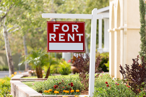 close up of a for rent sign